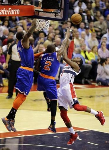 Washington Wizards guard John Wall (right) tries to shoot over New York Knicks  guard Raymond Felton (center) and forward Amare Stoudemire in the second half of an NBA basketball game, Wednesday, Feb. 6, 2013, in Washington. The Wizards won 106-96.