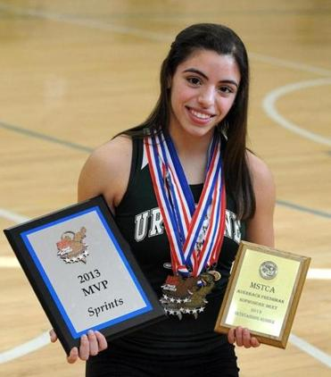 Ursuline Academy sophomore Amy Piccolo holds some of the awards and medals she has won.