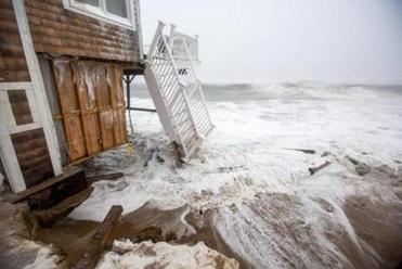 At least a dozen Plum Island homes were damaged by the sea in the February blizzard.