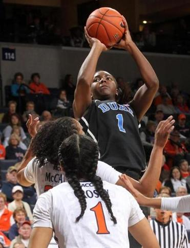 Duke center Elizabeth Williams (18 points) takes aim over Virginia's Telia McCall and China Crosby.
