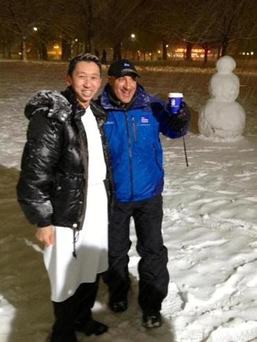 Andrew Yeo (left) executive chef of The Ritz-Carlton, hung with Jim Cantore, of the Weather Channel, on Boston Common.
