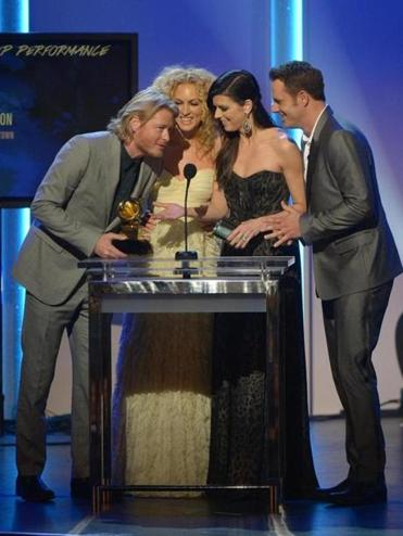 Little Big Town — (from left) Phillip Sweet, Kimberly Schlapman, Karen Fairchild, and Jimi Westbrook — accepting the Grammy for best country duo/group performance on Sunday.