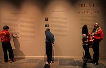 The exhibit also inlcudes wall texts detailing the painting's history.
