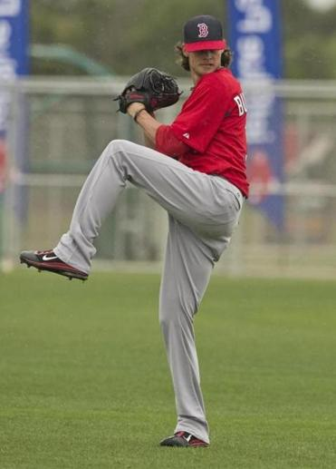 Clay Buchholz tested his sore right hamstring by throwing from 120 feet and said he felt fine.