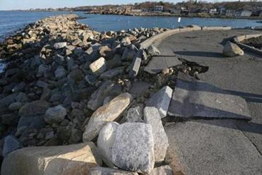 Erosion damage to the road at Bear Skin Neck in Old Harbor.