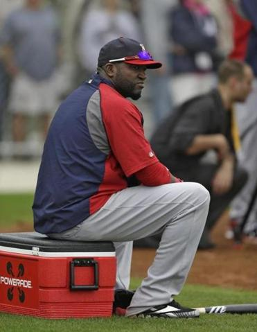 David Ortiz, mending a strained Achilles', took batting practice Friday, and also sat out portions of the Red Sox' first full-squad workout.