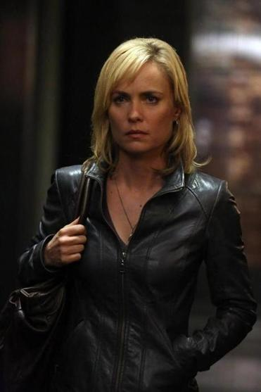 Radha Mitchell plays a mom who becomes a mob criminal after her husband is killed.