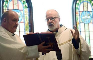 Cardinal Sean P. O'Malley (right) celebrated Mass at the Pastoral Center in Braintree.