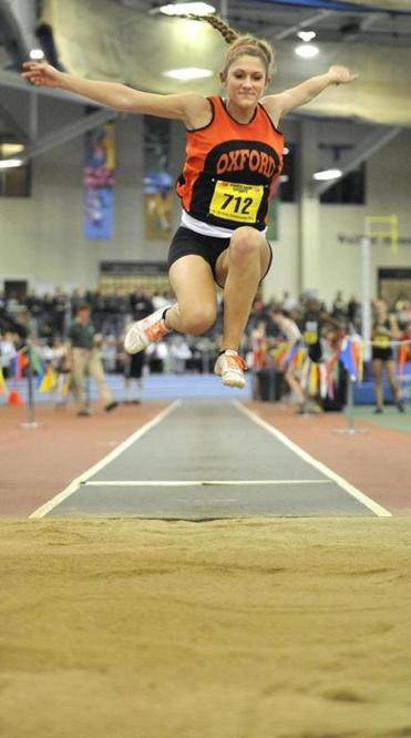Oxford's Emily Dawidczyk skies 17 feet, 9½ inches for first place in the long jump. She also won the 55-meter hurdles.