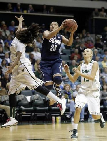 UConn's Kaleena Mosqueda-Lewis drives between two South Florida defenders for 2 of her career-high 32 points.