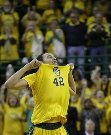 Baylor's Brittney Griner scored a Big 12-record 50 points and dunked in the Lady Bears' rout.