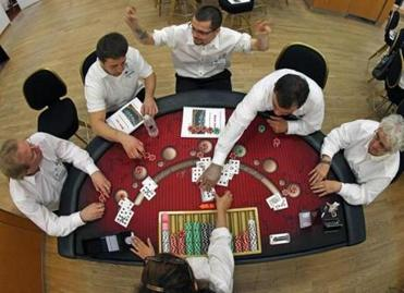 Chris Bois (top center), a student at the New England Casino Dealer Academy, reacted during blackjack class.