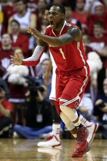 No. 14 Ohio State denied No. 2 Indiana its first outright Big Ten crown since 1993. Deshaun Thomas had a game-high 18 points.