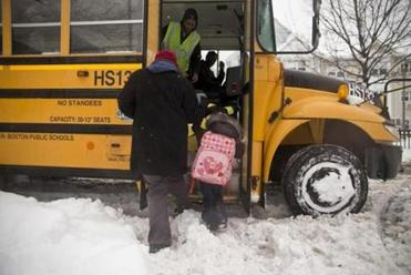 A student was helped onto a bus at Tobin K-8 School.