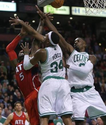 Atlanta's Josh msith draws the foul on this baseline drive against the Celtics combo of Paul Pierce and Jeff Green.