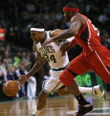 Celtics small forward Paul Pierce drove past Hawks small forward Josh Smith during the first quarter.
