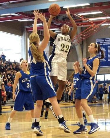 Alana Gilmre of Archbishop Williams rose to the challenge against Ashland's Gwenyth Ivory (14) and Annie Moore (right).