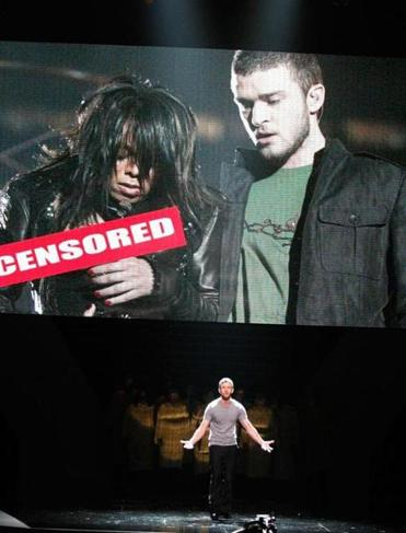 "Timberlake at the 2008 ESPY Awards joking about the Super Bowl ""wardrobe malfunction"" with Janet Jackson."