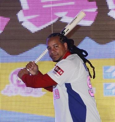Manny Ramirez poses in his new uniform on Tuesday.