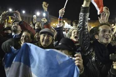 With some displaying Argentine flags, spectators greeted the papal announcement with jubilation.