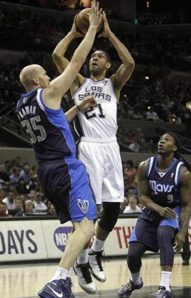 Tim Duncan shoots over Dallas's Chris Kaman for 2 of his 28 points to help the Spurs put away the Mavericks in San Antonio.