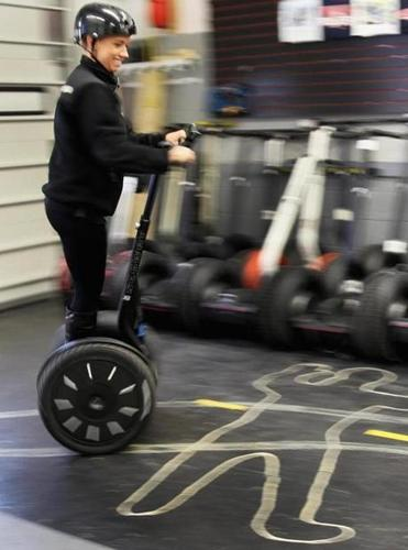 Alisha Strand of Seattle hopped on a Segway before heading out on a tour with Boston Gliders.