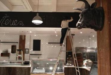 Work is underway ay Bee's Knees, a new gourmet grocery that is set to open in the Fort Point this week.