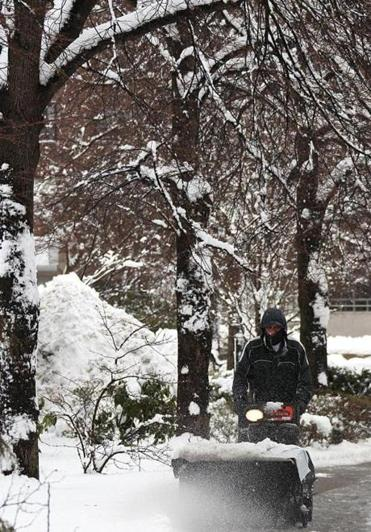 A worker plowed a sidewalk in Boston's West End on Tuesday.
