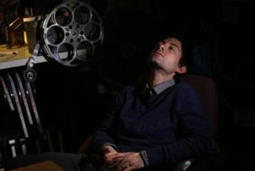 "Shane Carruth (at the Brattle Theatre) says he was inspired to make his new movie after debating politics with his brothers and he wondered what if ""somebody were just to wake up, and had to rebuild the way they think, based on whatever information was there?"""