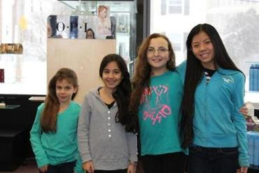 Solomon Schechter Day School of Greater Boston students (left to right) Jordan Cutler of West Roxbury (first grade), Talia Borensztajn of West Roxbury (third grade), Talia Harlow of Newton (sixth grade), and Emma Nesson of Newton (seventh grade) each donated 10 inches of their hair to Locks of Love.