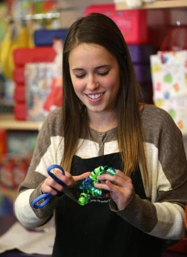 Sarah McGowen, 17, at work at Learning Express, a toy store in Needham.
