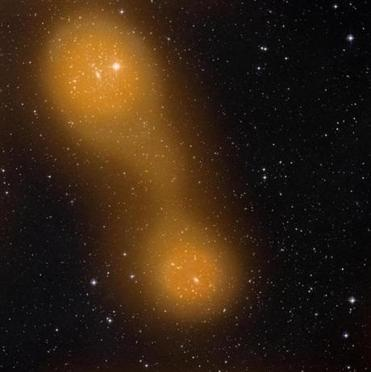 This image released on Thursday March 21, 2013 by the European Space Agency (ESA) from the Planck spacecraft shows a bridge of hot gas that connects galaxy clusters about a billion light-years from Earth. (AP Photo/ESA Planck Collaboration)