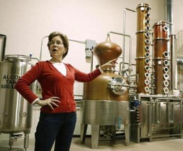Kathy Ryan talks about the still at the Ryan & Wood Distillery in Gloucester, Mass. Monday, March 25, 2013. (WINSLOW TOWNSON FOR THE BOSTON GLOBE)