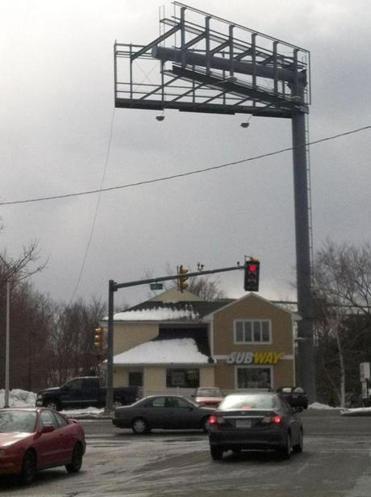 A view of the 92-foot billboard structure from Bourbon Street exiting onto Lowell Street in Peabody.