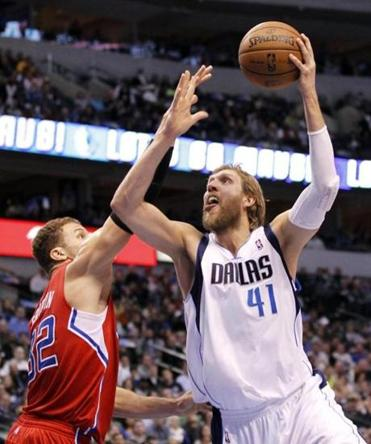 Dirk Nowitzki had 33 points, including the first 8 in OT, and stood tall against Blake Griffin and the Clippers.