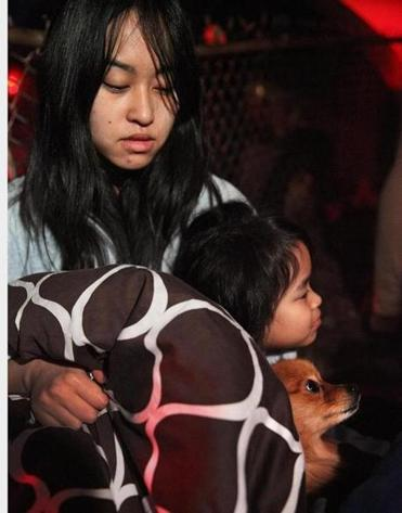 Sokha San, daughter, Kylie Oum, 5, and their dog Rosie were driven from their third-floor apartment at 12 Fox St.