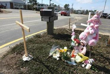 Mourners set up a memorial at the scene of the fatal accident.