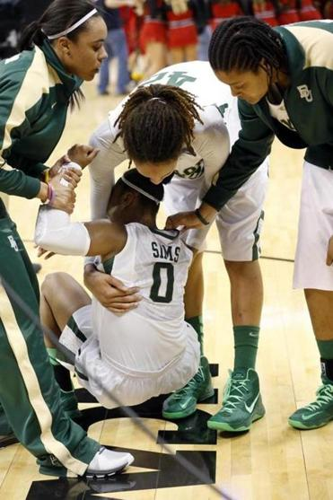 Baylor's Brittney Griner consoles teammate Odyssey Sims after the Lady Bears' loss.