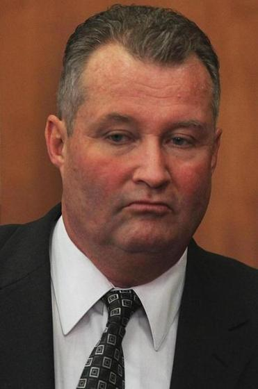 Former probation chief John J. O'Brien faces bribery charges.