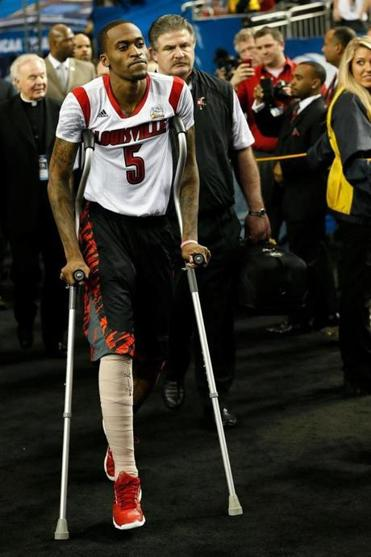 Injured guard Kevin Ware heads to the Louisville bench before Saturday's game.