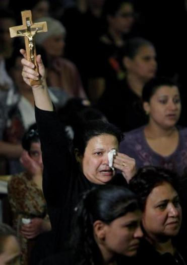 A funeral was held in Cairo on Sunday at St. Mark Coptic Orthodox Cathedral for four killed in sectarian clashes during the weekend.