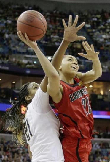 Louisville guard Bria Smith (17 points) goes around California's Reshanda Gray on this second-half drive.
