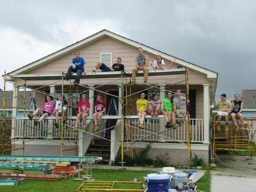 Mansfield High School students on scaffolding working in Bay St Louis, Mississippi.