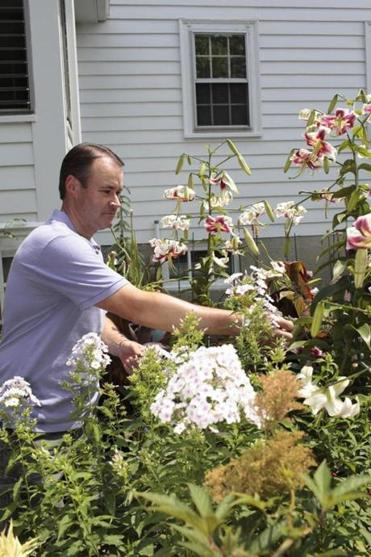 Paul Cook in his Quincy garden.