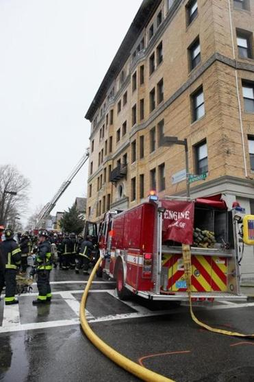 Firefighters extinguished a fire that began in the basement of a Monadnock Street building in Dorchester on Friday.