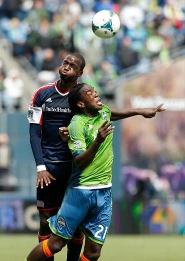 New England's Kalifa Cisse and Seattle's Shalrie Joseph battle for a header.