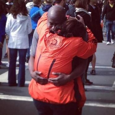 Two people embrace after the bombings.
