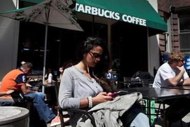 Shermine Kaschani relaxed at the Starbucks Coffee on Newbury Street as it again welcomed customers Wednesday.