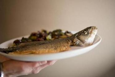 Roasted branzino is a whole filleted fish.