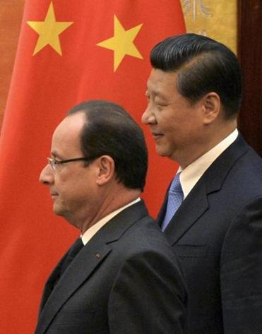 French leader Francois Hollande (left) and his Chinese counterpart Xi Jinping held trade talks.